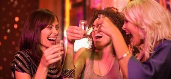Women drinking shots in a bar