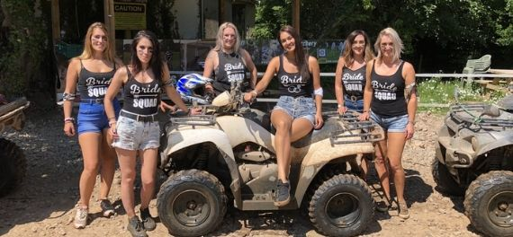 A group of women around a quad bike in Budapest