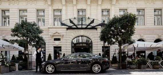 A car in front of the Aria Hotel Budapest