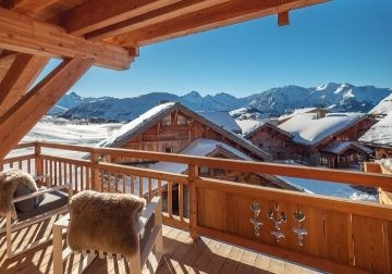 a snow covered ski chalet in the sun