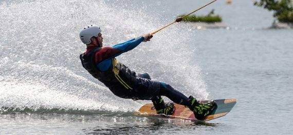 A man wakeboarding on a lake