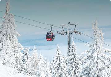 a ski lift and snow covered trees in Japan