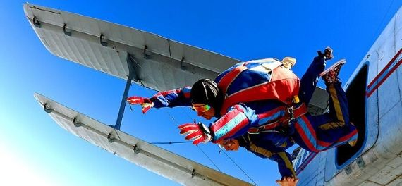 a tandem sky dive jumping out of a plane