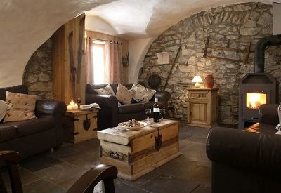 Leather sofas and an open fire in the stone built Chalet Chamois Volant