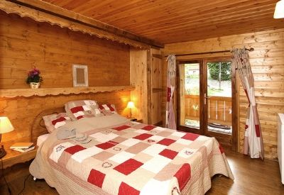 A traditional Alpine themed double bedroom in Chalet De Marie in Les Deux Alpes