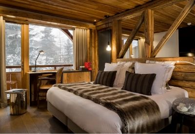 A luxury double hotel room in traditional alpine style at Hotel Chalet Mounier