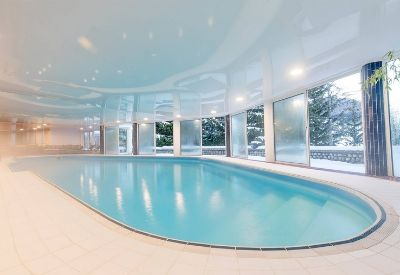 A large indoor heated swimming pool at the ski Hotel Ibiza