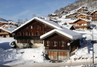 The outside of Chalet Beziere in Morzine surrounded by snow