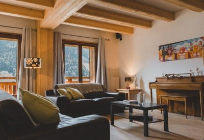 The living room in Chalet & Apartment Cordee with sofas and a piano