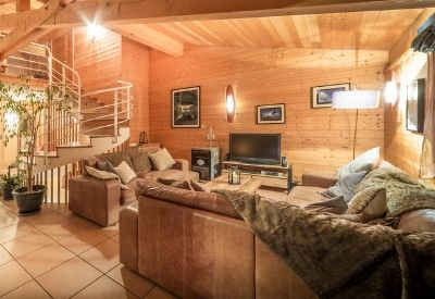 The living room with wood cladding in Chalet Laurent