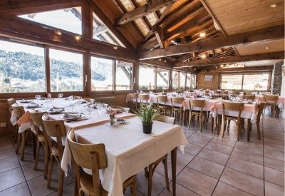 The restaurant in Hotel Beau Regard with views of snow covered mountains