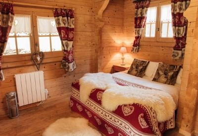 A double hotel room in traditional Alpine style at Hotel La Kinkerne