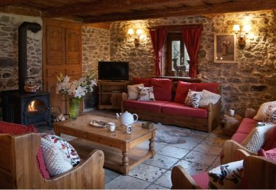 A living room in La Ferme, a traditional Alpine building made of stone