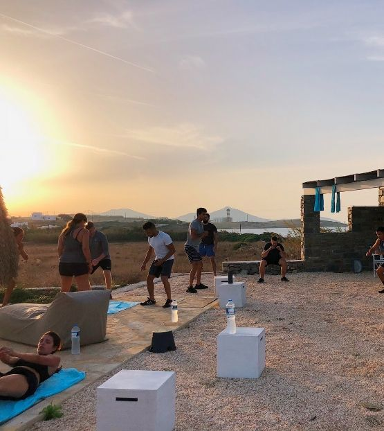 people working out at sunset outdoors