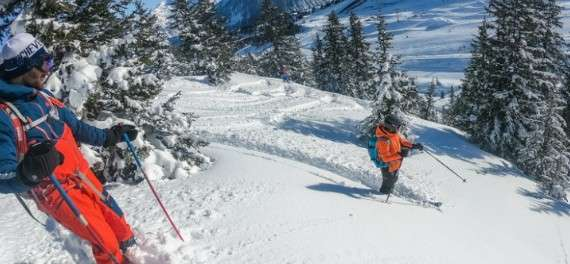 Two people skiing in Courchevel