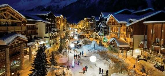 People walking on Val d'Isere high street at night