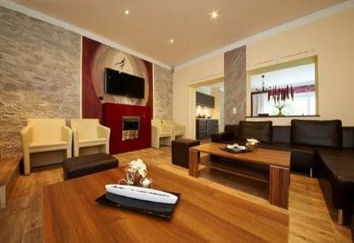 A large ski chalet living room with big sofas and a TV