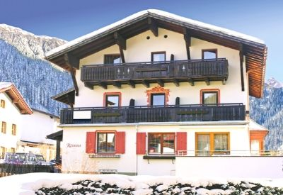 The outside of a freestanding ski chalet built in the Austrian style