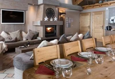 The living room in a ski chalet with an open fire