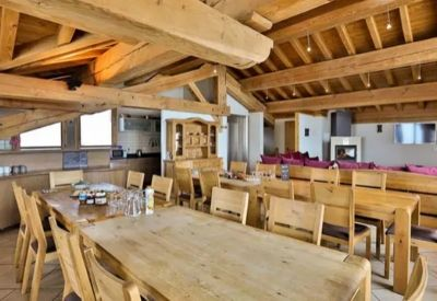 The dining area of a large ski chalet with two tables