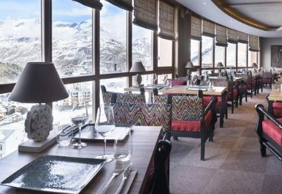 A high-end hotel restaurant with views over the ski resort of Tignes