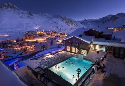 A rooftop swimming pool surrounded by snow in the ski resort of Tignes