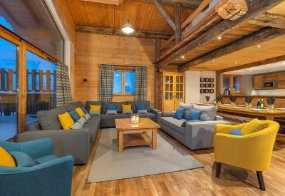 An open plan luxury ski chalet with views of the mountains