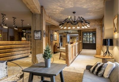 A high end hotel reception decorated in an Alpine style