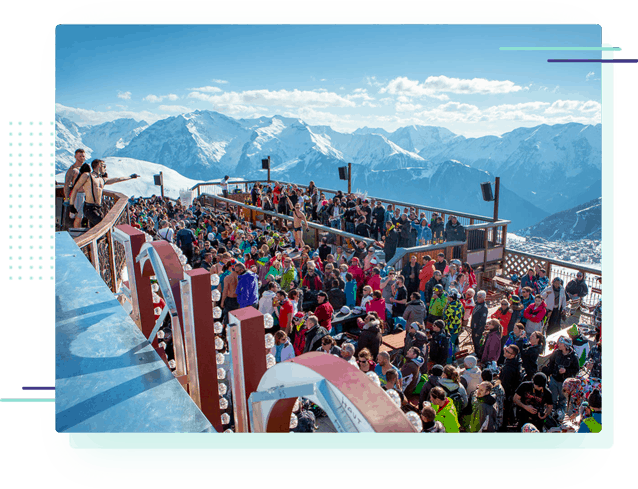 a large outdoor party at the Folie Douce apres ski bar in Alpe d'Huez