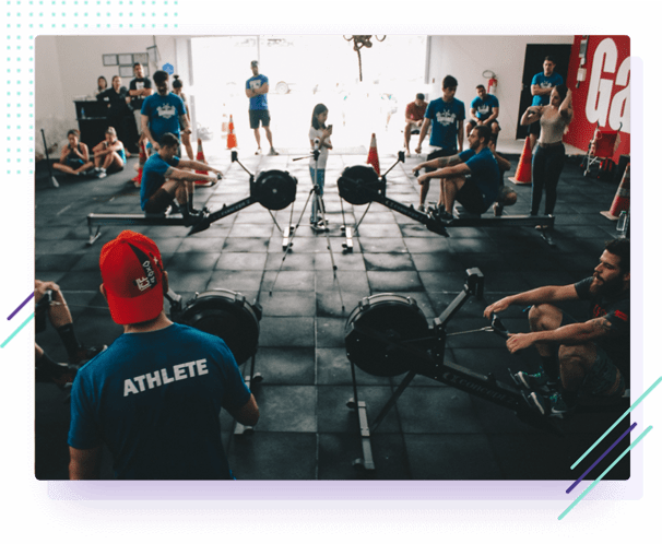a group of people training in a CrossFit gym