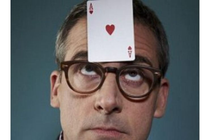 A man with a playing card on his forehead