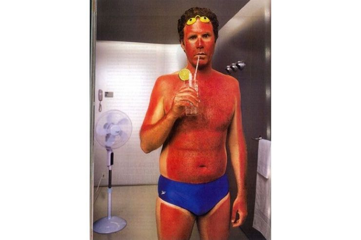 Will Ferrell with bad sun burn drinking a cocktail