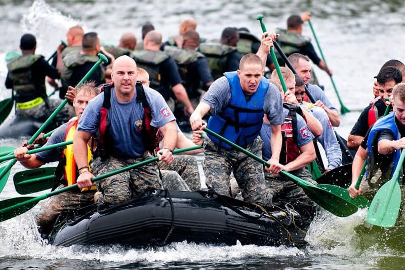 group of men doing white water rafting