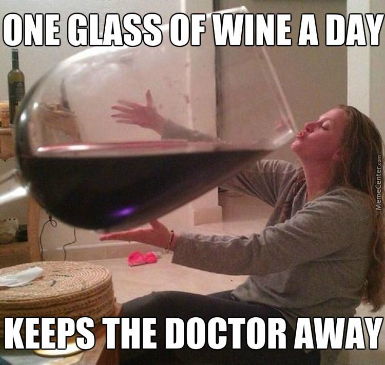 A woman with a huge glass of wine
