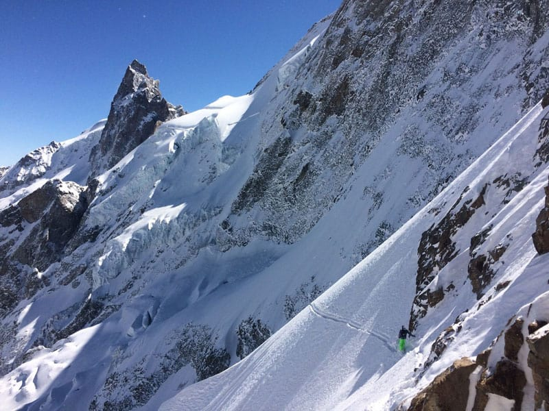 One person standing towards the top of the La Grave ski run, France