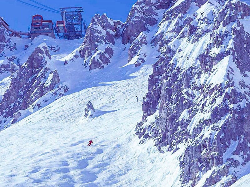 two skiers on le grand couloir in courchevel, france