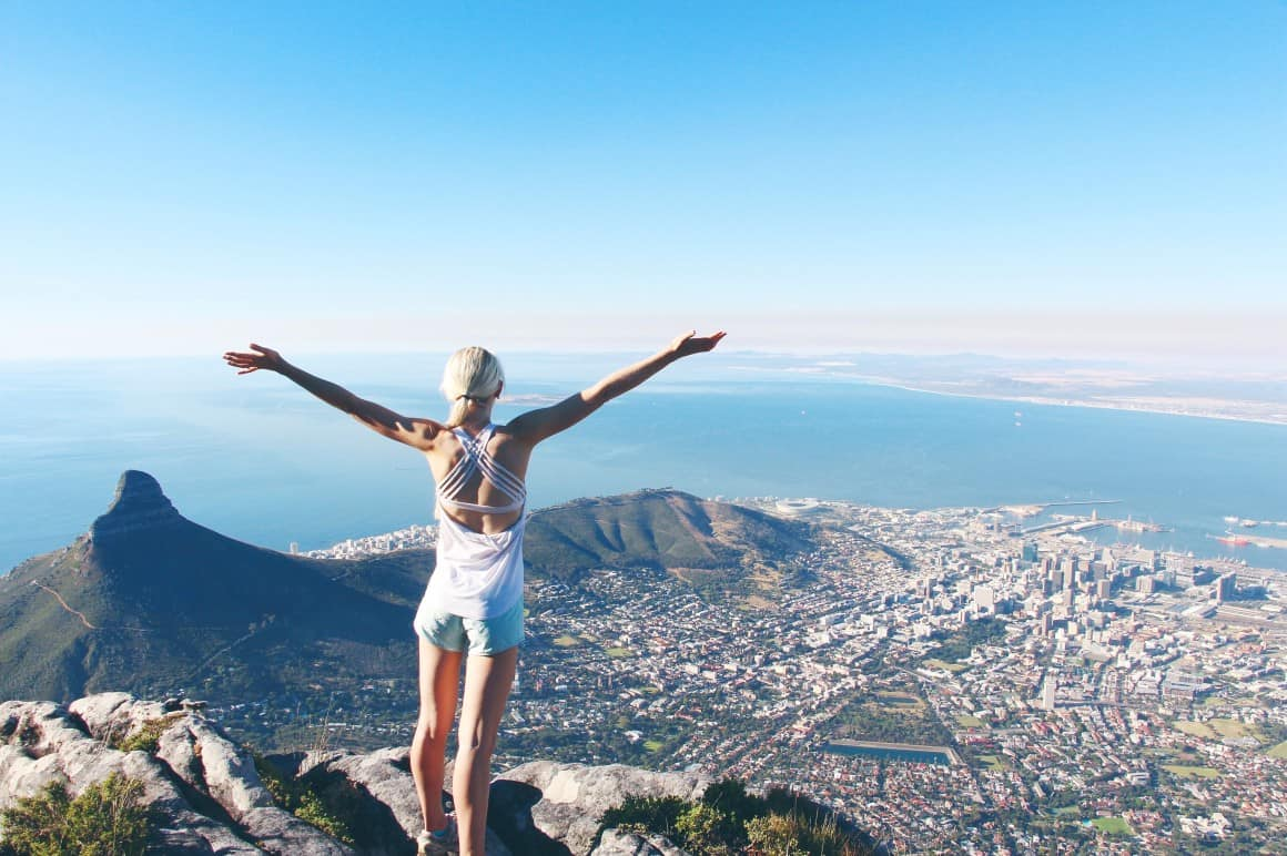 woman standing at the top of table mountain in cape town south africa