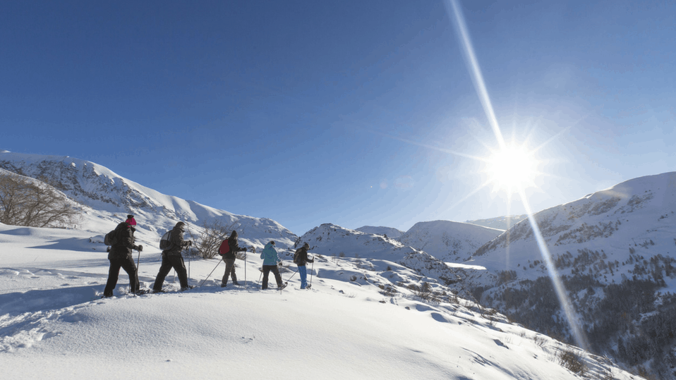 walkers snow-shoeing in alpe d'huez, france
