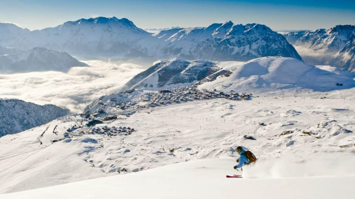 skiing in alpe d'huez france with stunning scenery in the background
