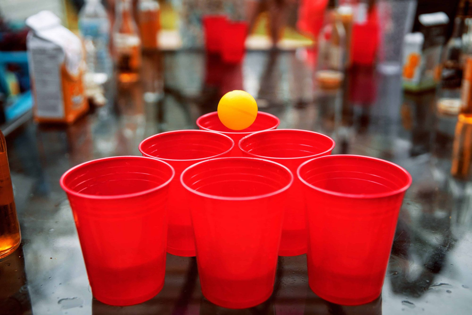 6 cups set up for a game of beer pong