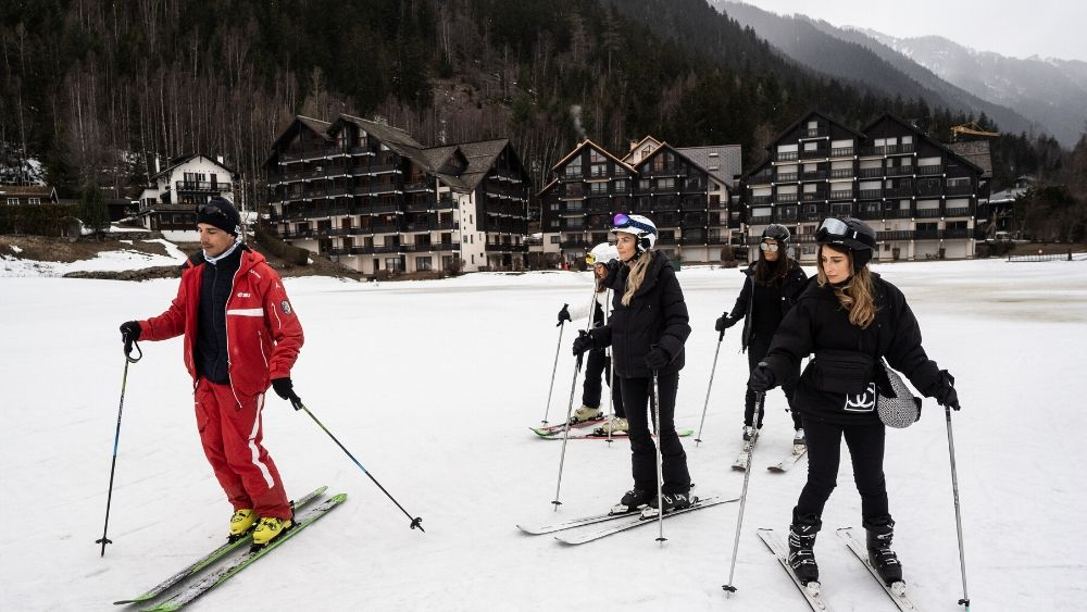beginner skiers in a ski lesson
