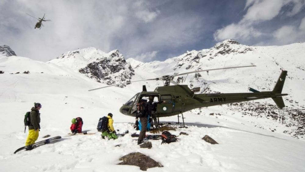 group of people heliskiing in Gulmarg, India